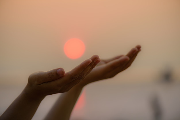 woman-hands-praying-blessing-from-god-during-sunset-background-hope-concept_53476-956