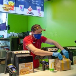 minsk-belarus-april-worker-protective-mask-issues-order-to-client-mcdonald-s-restaurant-lifestyle-coronavirus-179993274b