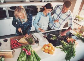 three-friends-cooking-kitchen-clearly-having-fun-shot-above-83938540